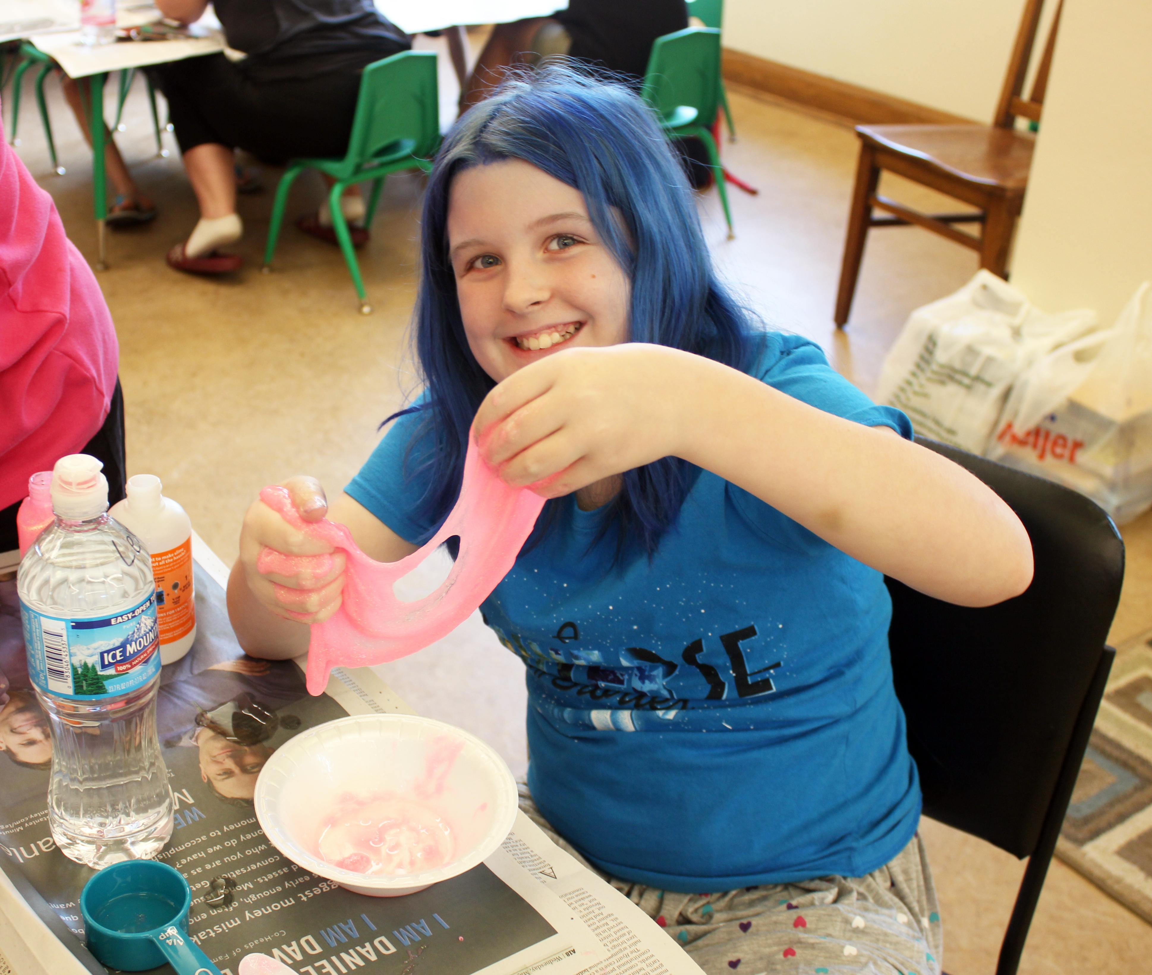 A girl making slime during a Summer Reading Program